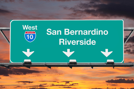 San Bernardino Riverside Interstate 10 west highway sign with sunrise sky. Stok Fotoğraf