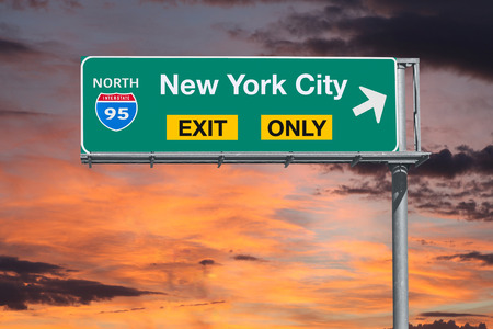highway sign: New York City exit only highway sign with sunrise sky. Stock Photo