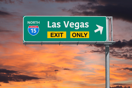 highway sign: Las Vegas Nevada exit only highway sign with sunrise sky. Stock Photo