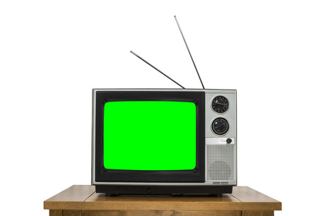 Vintage television on wood table isolated on white with chroma key green screen. Фото со стока