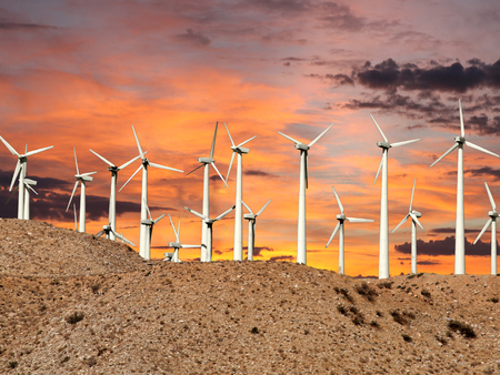 wind mills: Desert wind mills with sunrise sky.