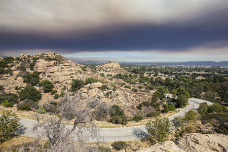 Smoke filled fire sky over the Stoney Point and the San Fernando Valley in Los Angeles, California, Stock Photo
