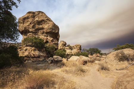 stoney point: Dry brush and smoke filled fire sky in the west San Fernando Valley area of Los Angeles, California.