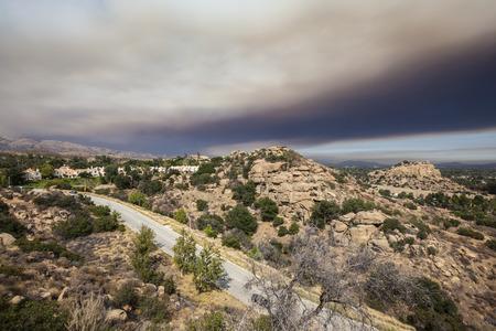chatsworth: Brush fire smoke sky over the suburban edge of Los Angeles, California.   Stock Photo