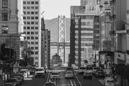 san: San Francisco, California, USA - January 14, 2013:  Black and white view of California Street with Bay Bridge background.