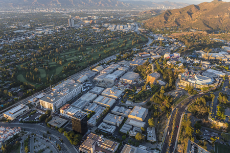 griffith: Los Angeles, California, USA - July 21, 2016:  Late afternoon aerial of Universal City Studios, Burbank and Griffith Park.