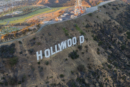 griffith: Los Angeles, California, USA - July 21, 2016:  Late afternoon aerial of the Hollywood Sign in Griffith Park.