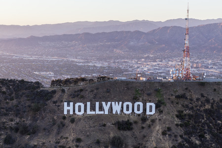 north hollywood: Los Angeles, California, USA - July 21, 2016:  Late afternoon aerial of the Hollywood Sign in Griffith Park with the San Fernando Valley and San Gabriel Mountains in background. Editorial