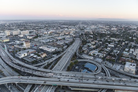 Los Angeles, California, USA - July 21, 2016:  After sunset aerial of the Harbor 110 and Santa Monica 10 freeways interchange south of downtown.
