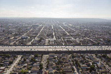 sprawl: Smoggy aerial of sprawling south Central Los Angeles and the Harbor 110 freeway.