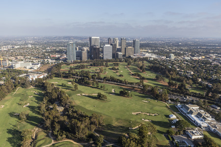 golf of california: Los Angeles, California, USA - August 6, 2016:  Afternoon aerial view of Century City towers and the Los Angeles Country Club Golf Course. Editorial