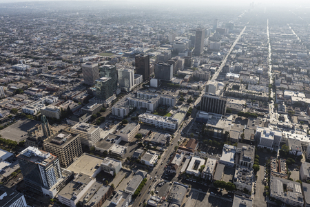 bl: Los Angeles, California, USA - August 6, 2016:  Smoggy summer afternoon aerial view of Wilshire Blvd in the center of Los Angeles.