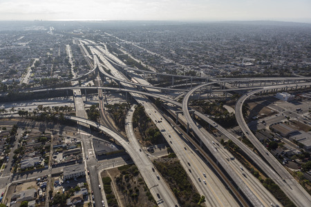 central california: Los Angeles, California, USA - August 6, 2016:  Afternoon aerial of the Harbor 110 and Century 105 freeways interchange in Southern California.