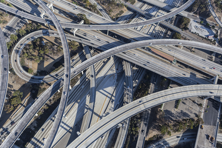 Aerial of Los Angeles 110 and 105 freeway interchange ramps and bridges in southern California. Stock Photo