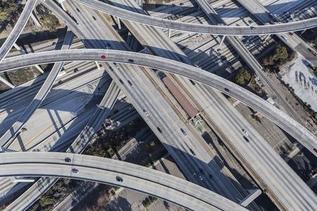 interchange: Los Angeles, California, USA - August 6, 2016:  Harbor 110 and Century 105 freeway interchange aerial south of downtown Los Angeles in southern California. Stock Photo