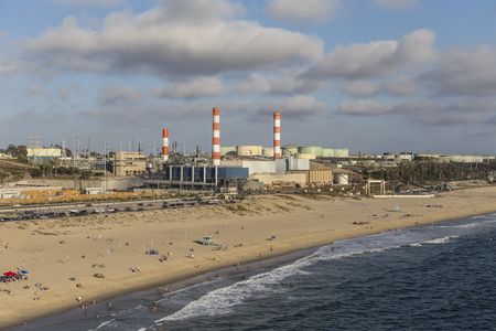 generating station: Los Angeles, California, USA - August 6, 2016:  Aerial view of Dockweiler State Beach, LADWP Scattergood power generating station and oil refinery tanks on an industrialized section of the southern California coast. Editorial