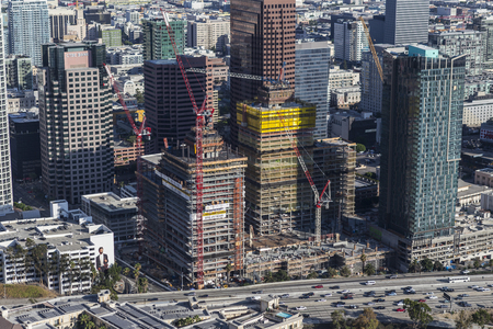 south park: Los Angeles, California, USA - August 6, 2016:  Afternoon aerial view highrise construction in the South Park area of downtown. Editorial