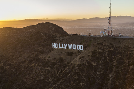 north hollywood: Los Angeles, California, USA - July 21, 2016:  Sunset aerial of the Hollywood Sign in Griffith Park with the San Fernando Valley and San Gabriel Mountains in background.