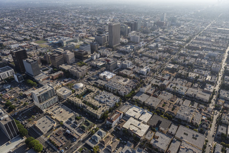 bl: Los Angeles, California, USA - August 6, 2016:  Aerial view of summer afternoon smog over the Mid Wilshire and Korea Town neighborhoods.