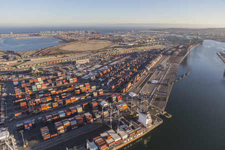 literas: Los Angeles, California, USA - August 17, 2016:  Afternoon aerial view of Port of Los Angeles berths, cranes and containers.