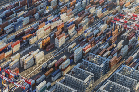 dockside: Los Angeles, California, USA - August 16, 2016:  Afternoon aerial view of cargo shipping containers stacked on docks.