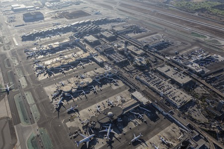 control tower: Los Angeles, California, USA - August 16, 2016:  Afternoon aerial view of the busy LAX terminals, control tower and parking garages. Editorial