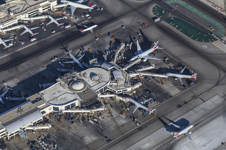 lax: Los Angeles, California, USA - August 16, 2016:  Afternoon aerial view of jet airplanes and terminals at LAX.