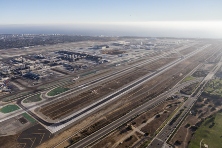 runways: Los Angeles, California, USA - August 16, 2016:  Afternoon aerial view of terminals, airplanes and runways at busy LAX. Editorial