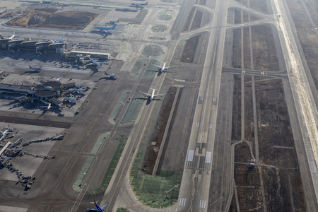 lax: Los Angeles, California, USA - August 16, 2016:  Afternoon aerial view of airplanes approaching runway at LAX. Editorial