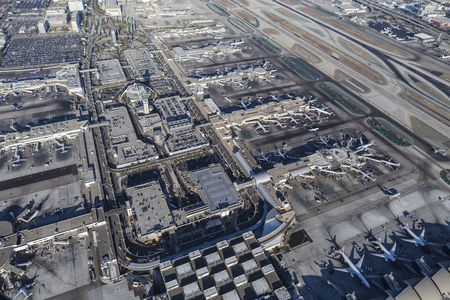 runways: Los Angeles, California, USA - August 16, 2016:  Afternoon aerial view of terminals, runways and airplanes at LAX. Editorial