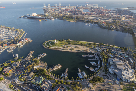 dockside: Long Beach, California, USA - August 16, 2016:  Afternoon aerial view of Rainbow Harbor, tour ships, aquarium and Queen Mary attractions. Editorial