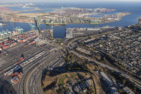 san pedro: Los Angeles, California, USA - August 16, 2016:  Afternoon aerial view of the Port of Los Angeles, Vincent Thomas Bridge and the community of San Pedro.