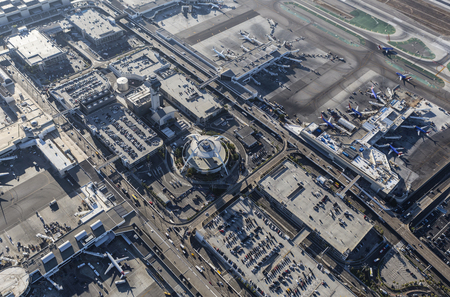 california delta: Los Angeles, California, USA - August 16, 2016:  Afternoon aerial view of LAX terminals, aircraft, control tower, and traffic.