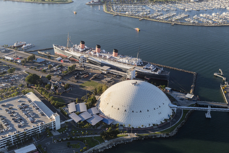 queens: Long Beach, California, USA - August 16, 2016:  Aerial view of the historic Queen Mary and cruise ship terminal dome.