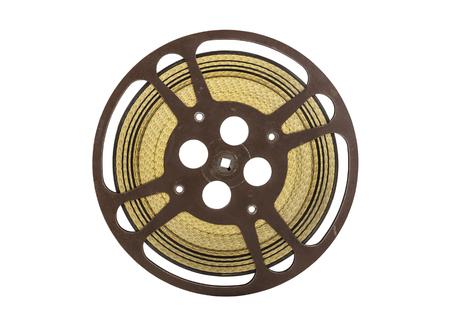 Vintage 16 mm movie film reel isolated on white.