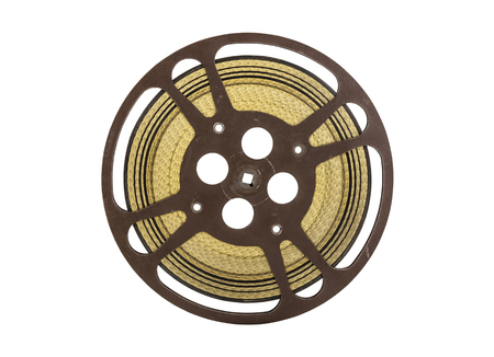 16mm: Vintage 16 mm movie film reel isolated on white.