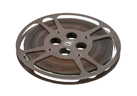 16mm: Old 16 mm movie film reel isolated on white.