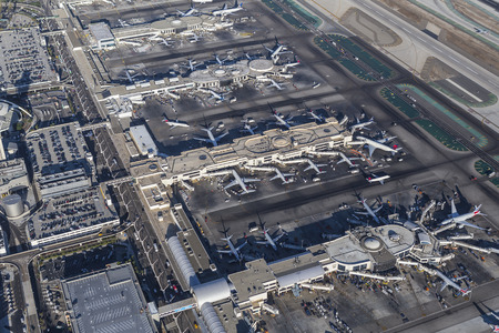 lax: Los Angeles, California, USA - August 16, 2016:  Aerial view of busy LAX terminals and jet airplanes.