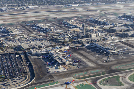 Los Angeles, California, USA - August 16, 2016:  Afternoon aerial view of Los Angeles International Airport terminals and runways. Editorial