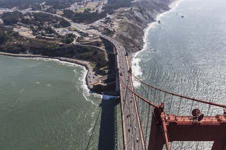 Aerial view above the Golden Gate Bridge towards Fort Point and San Francisco County.