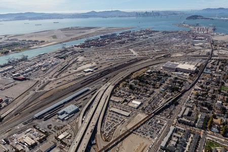 Oakland, California, USA - September 19, 2016:  Aerial view of San Francisco Bay, Alameda Island and Oakland Harbor.