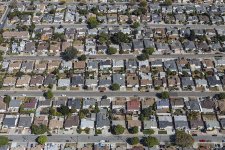 Aerial view of rows of middle class homes near San Leandro and Oakland, California.