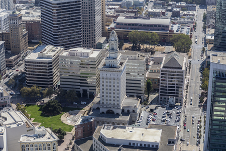 building structure: Oakland, California, USA - September 19, 2016:  Aerial view of Oakland City Hall and downtown architecture.