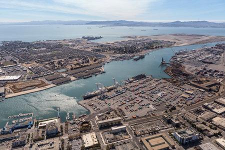 Oakland, California, USA - September 19, 2016:  Aerial view of the Port of Oakland, Alameda Island and San Francisco Bay.