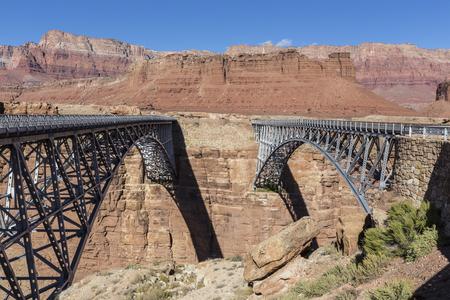 basin mountain: Marble Canyon bridges over the Colorado River at the Glen Canyon National Recreation Area in Northern Arizona. Stock Photo