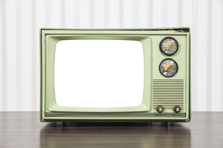 television set: Grungy green vintage television set with cut out screen. Stock Photo