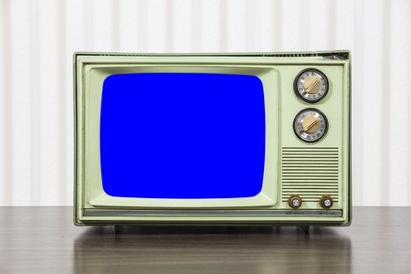 television set: Grungy green vintage television set with chroma key blue screen. Stock Photo