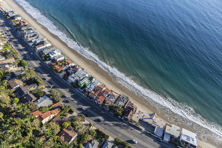 Aerial of beach homes along Pacific Coast Highway in Malibu California.