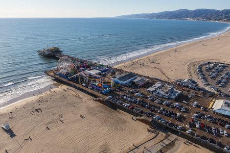 Santa Monica, California, USA - December 17, 2016:  Aerial of Santa Monica Pier and beach near Los Angeles California.