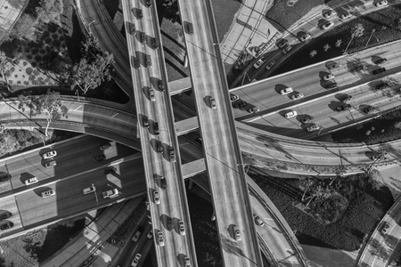 interchange: Black and white aerial view downtown four level interchange of the Harbor, Pasadena and Hollywood Freeways.